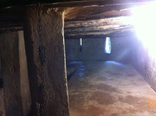 The Stone Holding cell for slaves; Does not convey the claustrophobia, heat, and humidity.